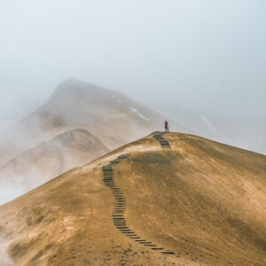 a person hiking in Landmannalaugar geothermal area