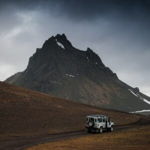 A jeep driving in the Icelandic landscape